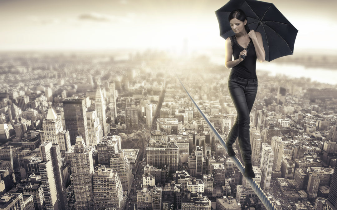 lady on a tight rope walking over a city
